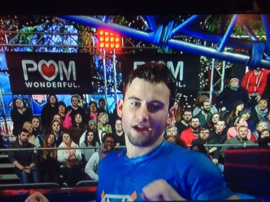 """Drew Knapp of Suamico hit the water after falling from the rolling log on """"American Ninja Warrior."""""""
