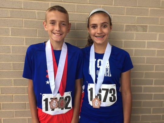 Mychal, left and Brook Lynn Bartal of Lebanon pose with their Keystone Games medals.