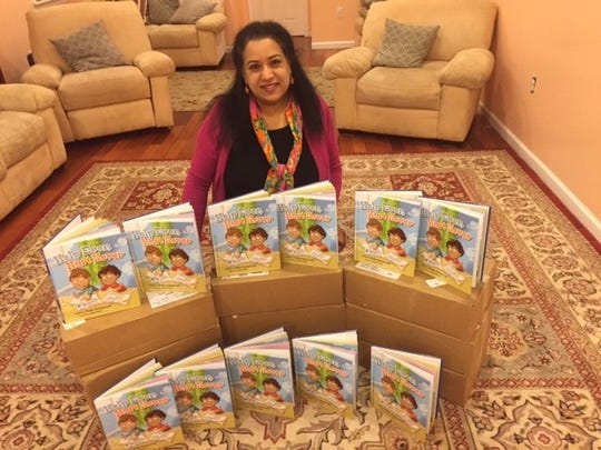 Local author Sudha Ramaswami with some of her published books.