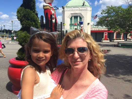 Marite Vanegas, visiting from Miami, with her granddaughter