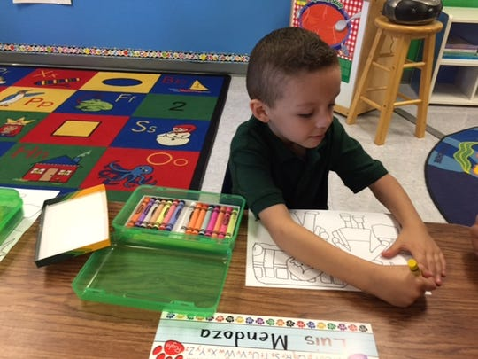 Luis Mendoza breaks out the crayons in Rosemary Garcia's kindergarten class during the first day of school at John Kelley Elementary in Thermal on Wednesday, Aug. 17, 2016.