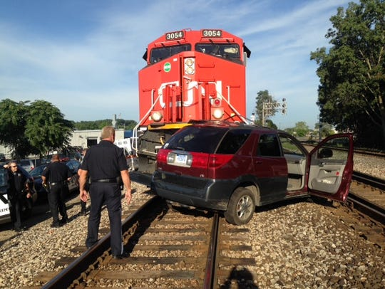 A CN freight train and an SUV collided at the Kendall