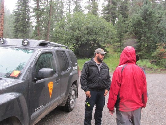 Incident Commander Brian Hamilton, left, came from