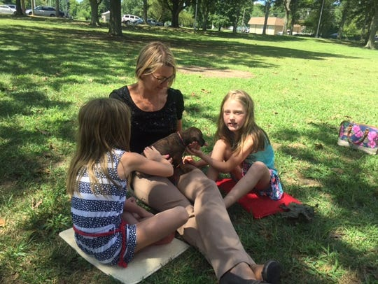 The Lewis family spent outdoor time reading with a