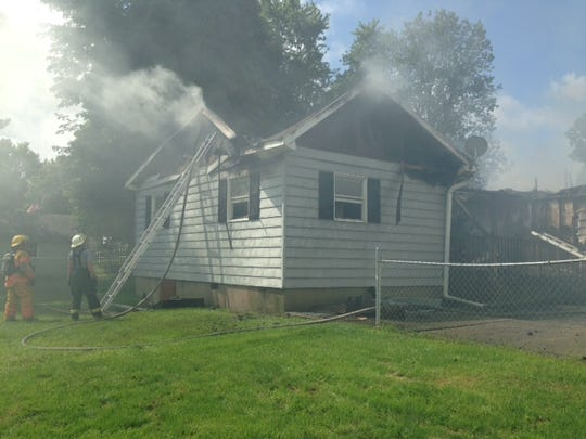 The rear of a house at 6412 2-Mile Road that was destroyed by fire on Thursday morning.