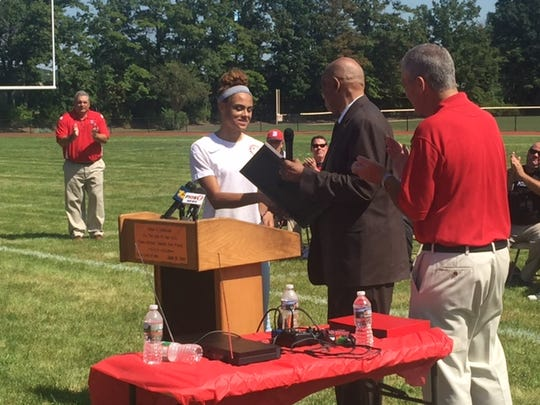"""More than 500 came to Columbia Park in Dunellen to welcome 17-year-old Olympian Sydney McLaughlin home Saturday. The youngest track and field member of Team USA was honored with the """"keys to the city,"""" a state proclamation and the unveiling of two """"Home of Olympian Sydney McLaughlin"""" signs."""
