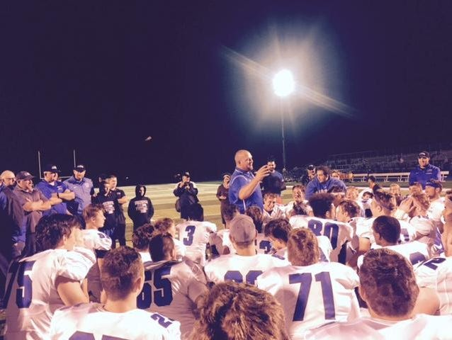 Utica Eisenhower coach Chris Smith addressed his team after a 26-13 win at Macomb Dakota on Sept. 1, 2016.