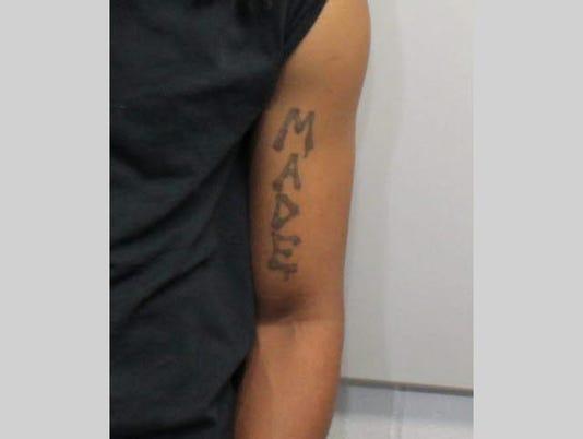 636088368995465425-Tavon-Jackson-JIS-tattoo-pic-1.jpg