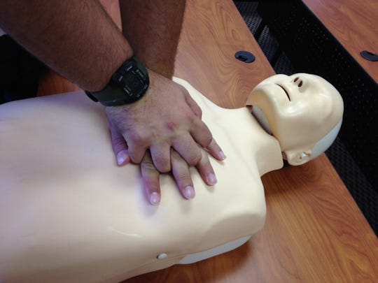 Lt. Chris Ruggiero of Greenville County EMS shows the proper placement of hands on a training mannequin