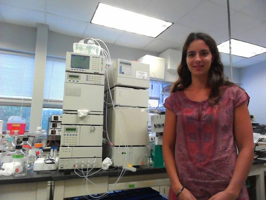 Eva Ternon, a postdoctoral researcher at the University of Delaware, stands in her lab.