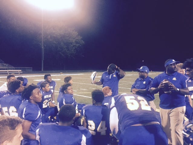 South Lake head coach Vernard Snowden addresses his team after Friday's win over Lakeview.