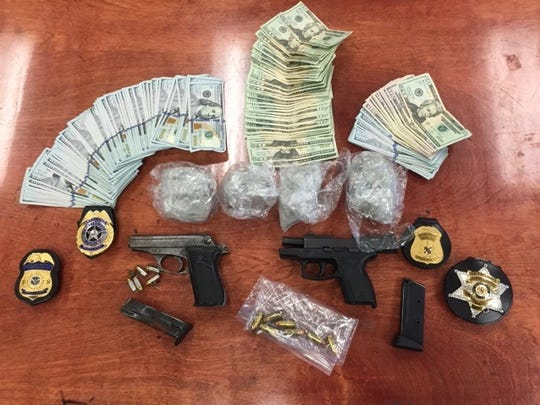 Maryland State Police released this image of recovered drugs, guns and money found during a search of a residence connected to an alleged heroin dealer.