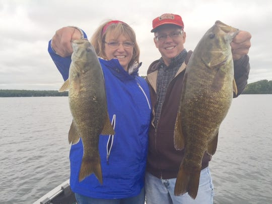 Cheri and Mark Holzer with a couple of big smallies.