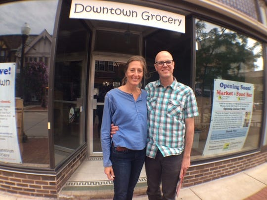 Owners of Downtown Grocery Megan Curtes Korpela and Kevin Korpela pose in front of the store that is beginning to go through renovations.