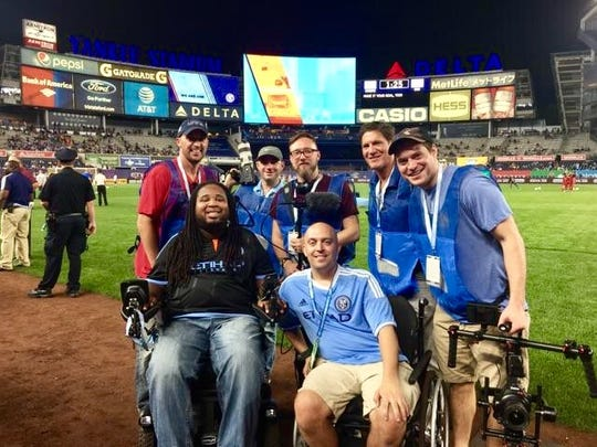 Eric LeGrand (front left) with Mike Luciano (front