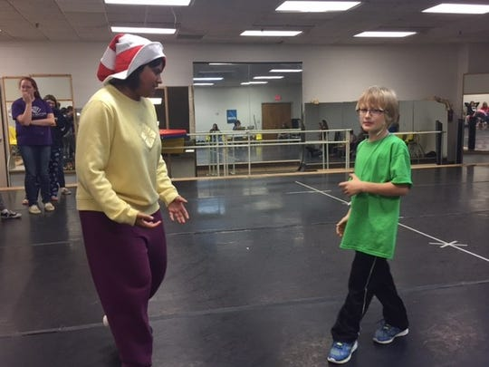 Jessica Berndt, 20, who plays Cat in the Hat, rehearses a song with Xavier Roberts, 8, who plays JoJo.