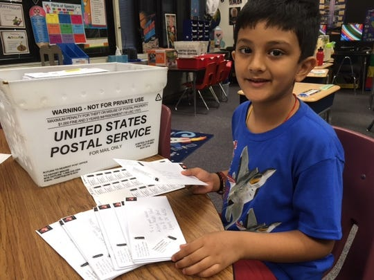 Yash's family donated a book of stamps to support Maggie Samudio's second-grade class's letter-writing campaign for the firefly.