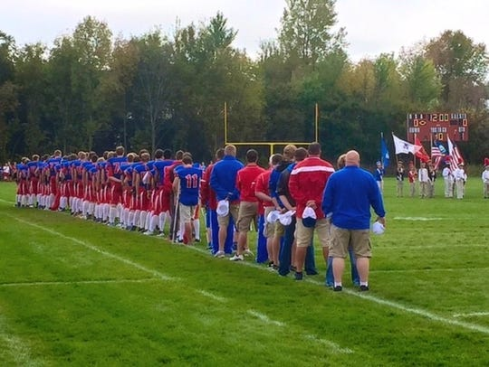 Upsala/Swanville players line up for the national anthem