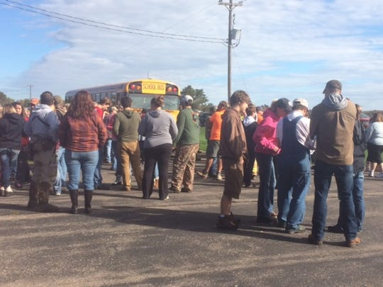 Volunteers await assignments Sunday morning in the search for a 3-year-old boy near Antigo