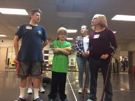 """Thomas Medvecz, 13, left, Xavier Roberts, 8, center and Elizabeth Blenker, 15, right, rehearse for """"Seussical Jr."""""""