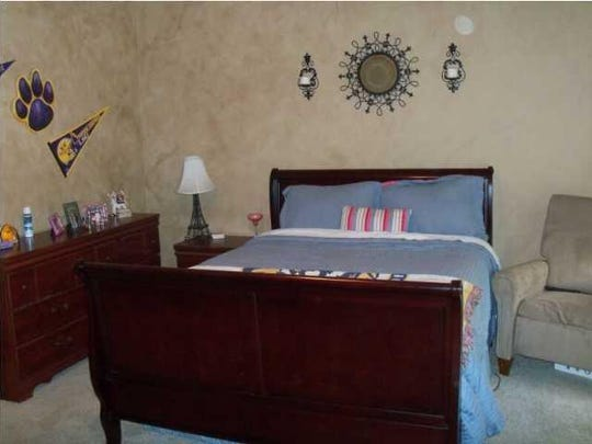 The master bedroom before renovation by Moniques Breaux, POSH Exclusive Interiors