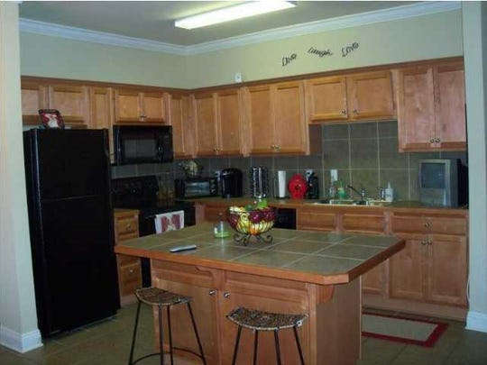 The kitchen island before renovation by POSH Exclusive Interiors
