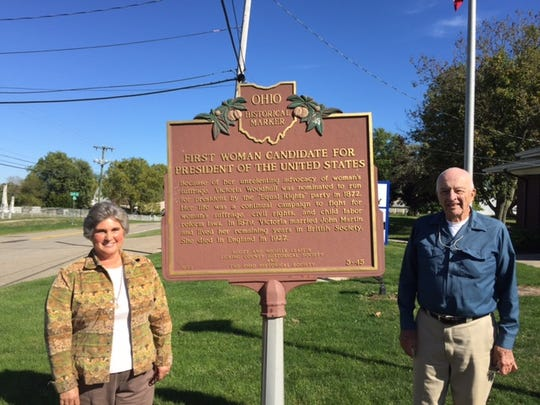 Amie Hatfield, director of the Homer, Ohio, Public Library, left, and Alan Megaw, right, a longtime resident, with a plaque commemorating Homer as birthplace of Victoria Woodhull, who in 1872 became the first woman to run for president.