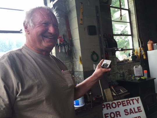 Roy Kleisch, the owner of the decommissioned base, shows off a radiation counter he found in one of the buildings on the base.