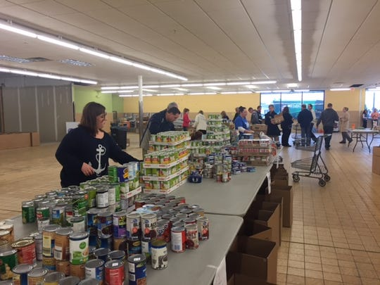 Make A Difference Day food drive donations were rolling