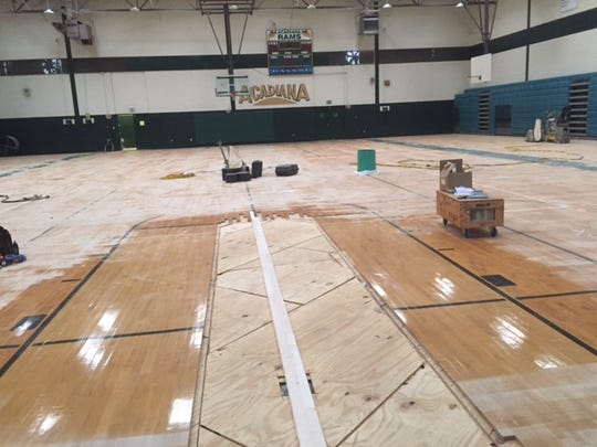 A look from behind a missing basket on the damaged side of the Acadiana High basketball court, caused by the August flooding.