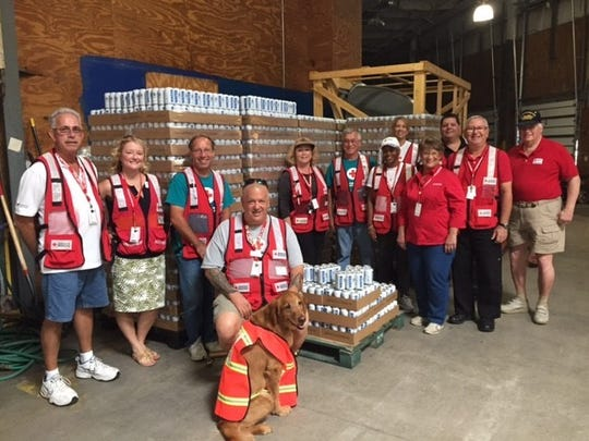Southern Eagle Distributing employees prepare to ship hundreds of cases of water to local nonprofit agencies.
