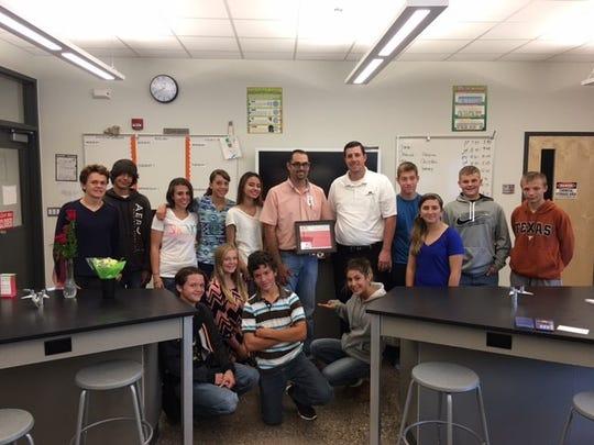 Capitan High School science teacher Christopher Scott,