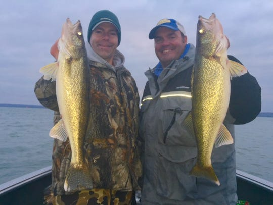 Scott Roppe and Nate Berg hoist up a pair of big walleyes