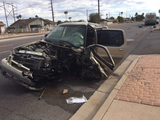 A car involved in a fatal crash with a Valley Metro bus sits on Southern Avenue in Phoenix on Nov. 3, 2016.