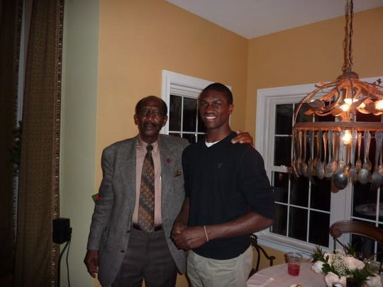 Vanderbilt football player Oren Burks, right, poses with his great-uncle Andrew Jackson White, a community activist in Petersburg, Va.