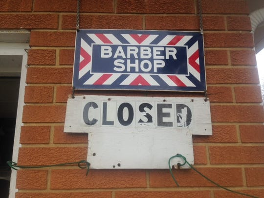 After 61 years, Darel Sterner's barbershop sign says