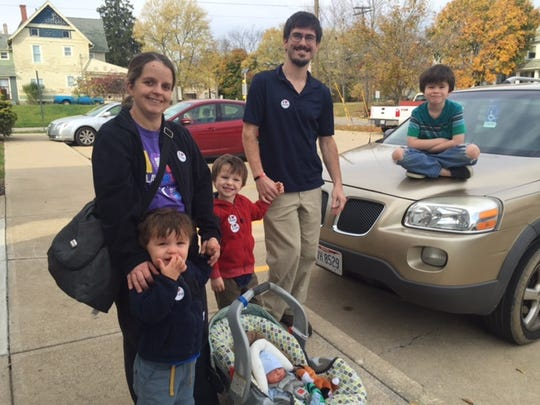 The Fox family, Jadae' and Melissa and Titus, a newborn, Josiah, 2, Ezra, 5 and Malachi, 8, made voting a family affair Tuesday at the St. Peter's Franciscan Activity Center.