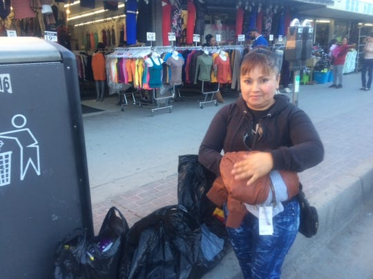Liliana Tabares, a resident of the Puerto de Palos neighborhood in southeast Juárez, had already spent $70 in jackets, shoes and small gifts for her three daughters Wednesday afternoon in Downtown El Paso.