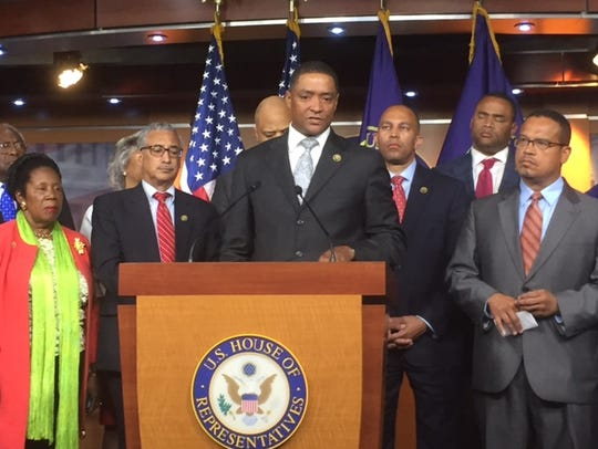 Rep. Cedric Richmond, D-La., (center), joined other