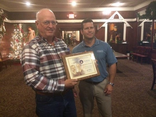 Charles McCleary of Ozona receives the The Wright Brothers Master Pilot Award for 50 years of flying from Craig Patterson with the FAA in Lubbock.