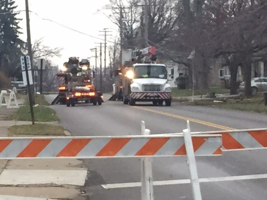 A portion of South Main Street remains closed Tuesday while Ohio Edison crews repair power following an early morning crash where a vehicle struck a power pole.