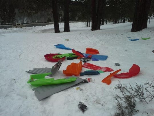 Take Care Tahoe Discarded broken sleds at Spooner Summit.