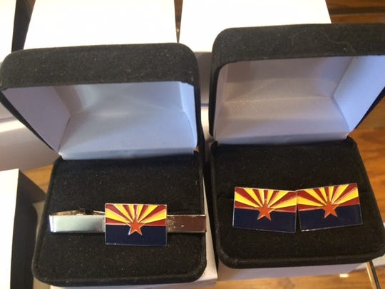 Tie tacks and cuff links in the image of Arizona's state flag