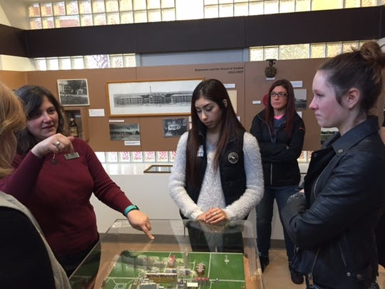 Oregon Connections Academy students listen to Oregon State Hospital Museum of Mental Health curator Megan Lallier-Barron, left, explain the tunneling system from the old hospital, which was used to get from one building to another. ORCA 11th-grade student Natalie Reyes from Salem, Jodie Ginsbach, high school advisor/teacher from Salem, and 9th-grader Mikayla Wood from Scio, left to right, enjoyed the lesson. The online academy hosts more than 200 field trips across Oregon each year.