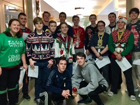 A Salesianum Spanish class spreads pre-midterm cheer caroling en Espanol while donning their 'ugly' Christmas sweaters.