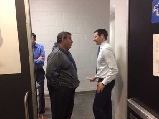 University of Delaware men's basketball coach Martin Ingelsby talks with New Jersey Gov. Chris Christie postgame.