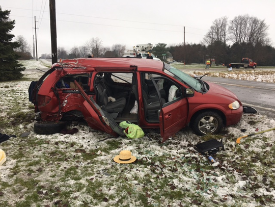 Four occupants of a van were injured, three of them