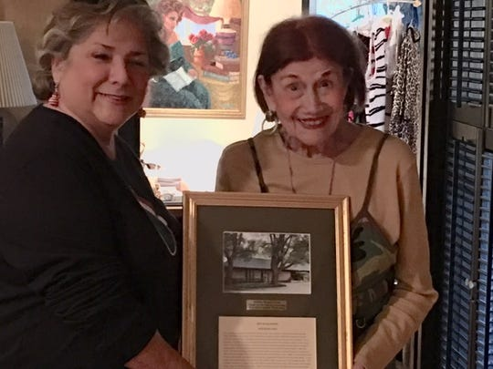 Debbie Blake presents Roy Helen Ackers with a gift