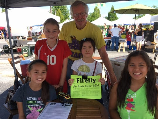 The students rallied at the Farmers Market in West Lafayette to get signatures for their petition to make Say's firefly the state insect.