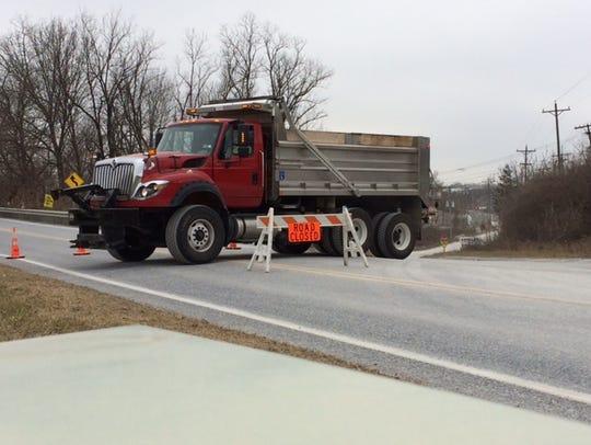 A dump truck blocks Hokes Mill Road near West King